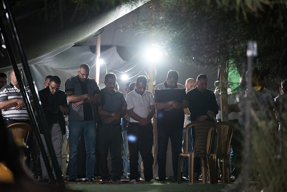 3 October 2018, Jerusalem, Occupied Palestinian Territories: Evening prayer, the 5th prayer of the day, caps off the day in Khan al Ahmar, a Palestinian Muslim community. Khan al Ahmar is a Bedouin community located within the East Jerusalem Periphery, in E1 area. It is home to 32 families, 173 persons in total, including 92 children and youths. The community has a mosque and a school, which was built in 2009 and serves more than 150 children between the ages of six and fifteen, from Khan al Ahmar and other nearby communities. With due date 1 October 2018, Israeli authorities threaten to demolish the site, thereby making room for nearby Israeli settlements to expand.