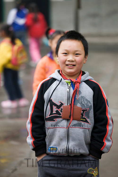 Young boy in the playground of a primary school in Fuli. China has a one child policy to limit population.