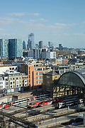 Elevated views overlooking Kings Cross Station with the city on the horizon on the 10th April 2019 in London in the United Kingdom.