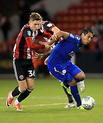 Sheffield United's David Brooks (left) and Leicester City's Leonardo Ulloa battle for the ball during the Carabao Cup, Second Round match at Bramall Lane, Sheffield.