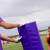 072915       Cable Hoover<br /> <br /> Dylan Joines gets some pointers from Miyamura Patrio John Rutherford during Miyamura football camp Wednesday at Miyamura High School.
