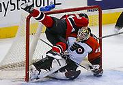 Ottawa Senators' Daniel Alfredsson crashes into Philadelphia Flyers' goalie Sean Burke (41) during NHL action in Ottawa.  REUTERS/Jim Young