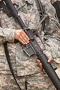 A woman Drill Sergeant candidate at the US Army Drill Instructors School Fort Jackson holds her weapon September 26, 2013 in Columbia, SC. While 14 percent of the Army is women soldiers there is a shortage of female Drill Sergeants.