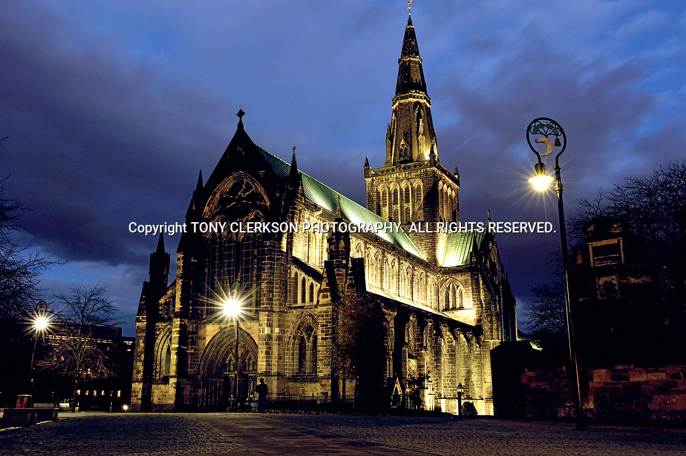 Glasgow Cathedral lit up under atmospheric sky