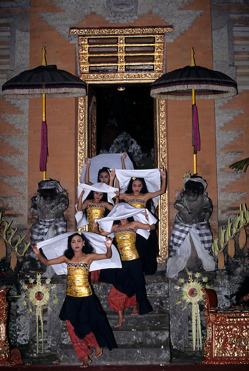 Asia, Indonesia, Bali, Ubud. Women carry white scarves in the traditional Barong dance