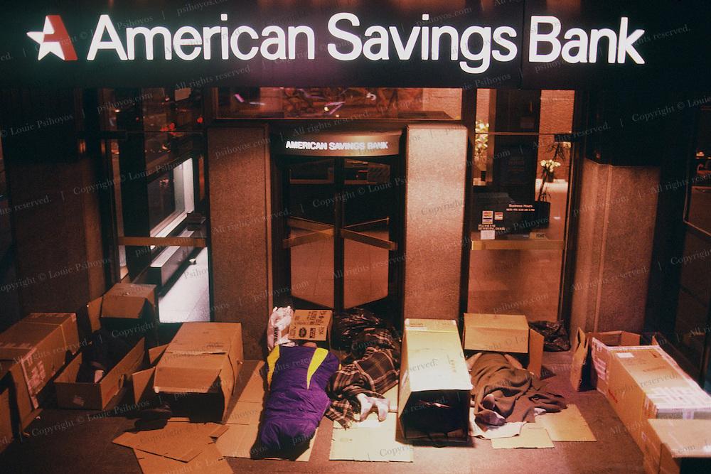 Homeless Sleeping outside the American Savings Bank in New York City.