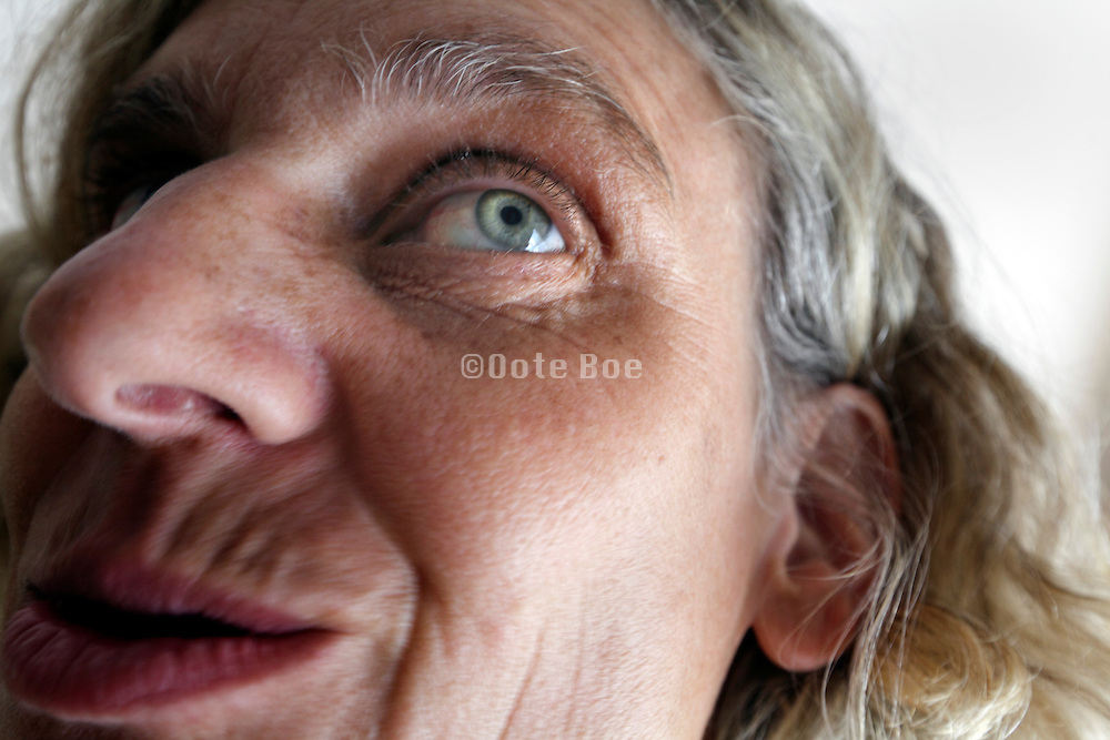 extreme deformed close up of the face of a female person