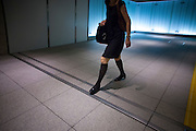 TOKYO, JAPAN, 1 SEPTEMBER - A woman in the undergrouds corridor of roppongi, between the Tokyo midtown and the Metro roppongi station - September 2012 [FR] Une femme aux longues chaussettes noires dans les sous terrains de Roppongi entre Tokyo Midtown et Roppongi hills