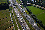 Nederland, Utrecht, Harmelen, 23-06-2010; verkeer op de A12, gezien naar het westen (richting Den Haag). Er is een file aan het ontstaan door een ongeluk een aantal kilometer verderop, het harmonica-effect.Traffic on the A12, looking west (direction Den Haag). A traffic jam is growing because of an accident several miles away, the harmonica-effect.luchtfoto (toeslag), aerial photo (additional fee required).foto/photo Siebe Swart