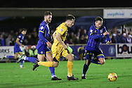 Dannie Bulman of AFC Wimbledon and Callum Kennedy of AFC Wimbledon chase down Ollie Clarke of Bristol Rovers during Sky Bet League 2 match between AFC Wimbledon and Bristol Rovers at the Cherry Red Records Stadium, Kingston, England on 26 December 2015. Photo by Stuart Butcher.