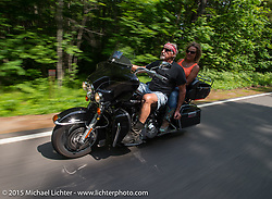 Bentley Warren and Lisa Zatalava riding from the Laconia Motorcycle Week headquarters in Weirs Beach, NH to Bentley's Saloon in Arundel, Maine. USA. June 17, 2014.  Photography ©2014 Michael Lichter.