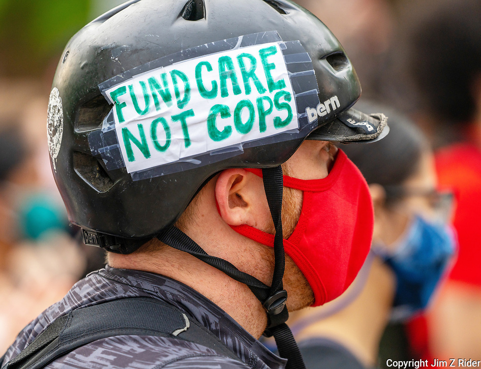 A protester expresses his views on the his bicycle helmet during a MOVE protest on Penn's campus.