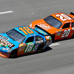 April 17, 2011; Talladega, AL, USA; NASCAR Sprint Cup Series driver Joey Logano (20) drafts Kyle Busch (18) during the Aarons 499 at Talladega Superspeedway.   Mandatory Credit: Derick E. Hingle