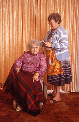 Elderly woman; who is wheelchair user; and carer,