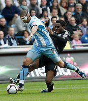 Photo: Steve Bond/Richard Lane Photography.<br />Coventry City v Chelsea. FA Cup 6th Round. 07/03/2009. Leon Best (L) is tackled by Jon Obi Mikel