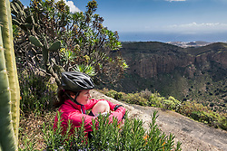 Tired mountain biker looking at distance