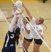 La Reina's Carolena Huseby, right, tips a shot over the net against St. Paul during the CIF-Southern Section Division 4AA semi-final on Nov. 11, 2015.