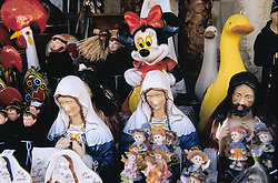 Europe, Portugual, Barcelos, Mickey Mouse, Jesus Christ and other ceramic statues in market