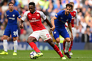 Danny Welbeck of Arsenal breaks away from  Cesc Fabregas of Chelsea. Premier league match, Chelsea v Arsenal at Stamford Bridge in London on Sunday 17th September 2017.<br /> pic by Andrew Orchard sports photography.
