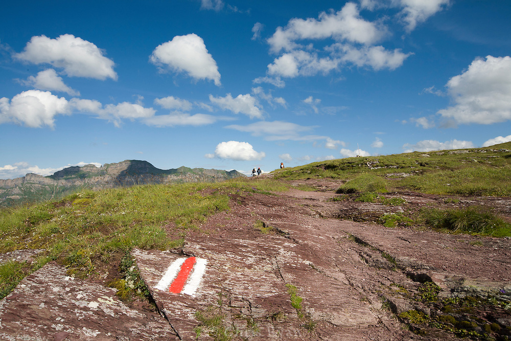 Hikers and trail marker in Swiss Alps, Flumserberg, Sarganserland, Switzerland