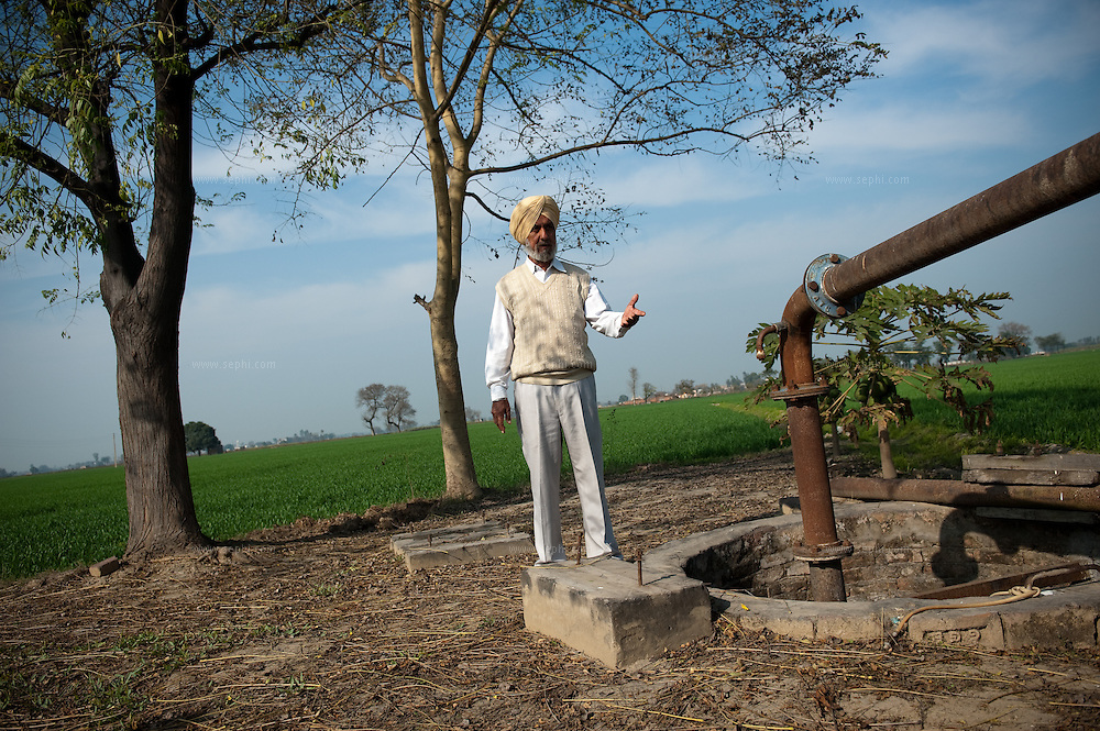Bhajan Singh Siddhu, a farmer in the village of Dhianomajra located about 40km from Chandigarh, next to the tubewell in his field. The water lavel in this well is only 50ft deep but he had spent Rs 50,000 (almost US$1,100) on diesel for his generator in the last season alone. Farmers in punjab are facing problems of depleting levels of underground water levels that in some places is as deep as 700ft. They complain that the state government does not supply enough electricity to use the pumps. They only receive 3-5hr of electricity per day and have to use diesel generators to pump the water for their fields.