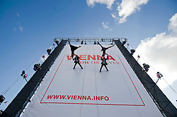 © Licensed to London News Pictures. 25/10/2011. London, UK. Photo Call for 'Vienna from a different angle - exhibition'. Vienna Tourist Board puts together the biggest structure ever seen in Trafalgar Square to offer visitors a new side of the Austrian city. The 21m high wall hosts acrobatic performances, plus a celebration of Viennese culture including music, artists, aerial displays and the famous waltz. Photo credit: Ben Cawthra/LNP