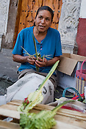 Mexico, Guerrero, Holy week in Taxco : A woman selling holy pictures made of bamboo