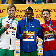Mauro Vinicius da Silva (C) of Brasil, Henry Frayne (L) of Australia and Aleksandr Menkov (R) of Russia display their medals during the awards ceremony for the men's long jump at the world indoor athletics championships at the Atakoy Athletics Arena in Istanbul March 11, 2012. Vinicius da Silva won the gold medal with a jump measuring 8.23 meters, ahead of Frayne who won silver and Menkov who won bronze. Istanbul, Turkey. Photo by TURKPIX