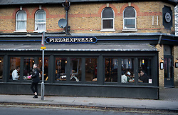 © Licensed to London News Pictures. 17/11/2019. Woking, UK. Customers enjoy a Sunday meal at Pizza Express in Woking, Surrey. Prince Andrew has stated, in an interview aired on the BBC last night, that he had taken his daughter Princess Beatrice to this restaurant on the night he is accused of sleeping with Virginia Roberts. Photo credit: Peter Macdiarmid/LNP