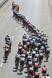 February 15, 2018 - Muscat, Oman - The peloton during stage 3 of the 9th edition of the 2018 Tour of Oman cycling race, a stage of 179.5 kms between German University of Technology and Wadi Dayqah Dam in Muscat, Sultanate of Oman.  (Credit Image: © Panoramic via ZUMA Press)