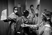 Nurses wearing protective equipment speak about patients, amid the coronavirus disease (COVID-19) outbreak, at the Saint-Pierre University Hospital - Brussels, April 22, 2020.