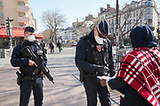 """March, 23rd 2020 - Paris, Ile-de-France, France: French CRS Police controlling the movement of French citizens to prevent the spread of the Coronavirus, during the eigth day of near total lockdown imposed in France. A week after President of France, Emmanuel Macron, said the citizens must stay at home from midday on Tuesday for at least 15 days. He said """"We are at war, a public health war, certainly but we are at war, against an invisible and elusive enemy"""". All journeys outside the home unless justified for essential professional or health reasons are outlawed. Anyone flouting the new regulations is fined. Nigel Dickinson/Polaris"""