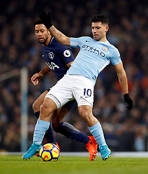Manchester City's Sergio Aguero (right) and Tottenham Hotspur's Mousa Dembele battle for the ball during the Premier League match at the Etihad Stadium, Manchester.