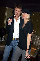 The HON.SOPHIA HESKETH and ROBIE UNIACKE at the launch party of Purple Lounge - a new poker web site, held at The Cuckoo Club, Swallow Street, London W1 on 30th November 2005.<br /><br />NON EXCLUSIVE - WORLD RIGHTS