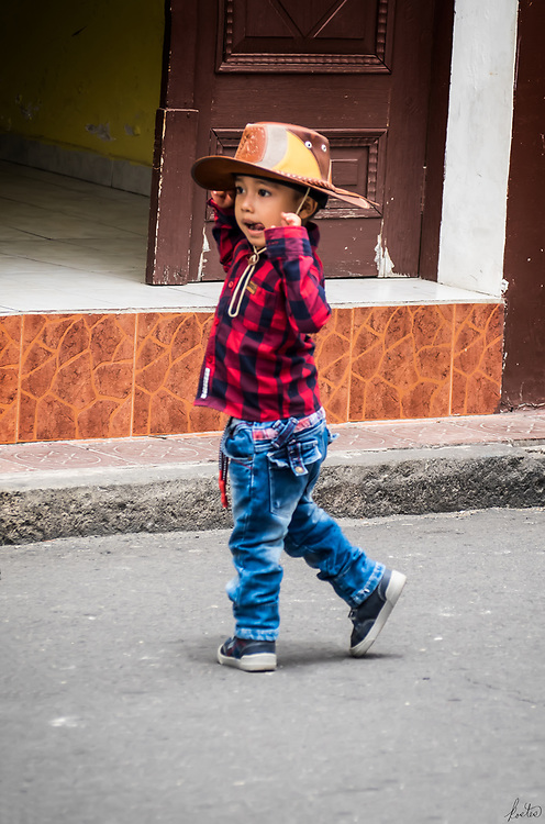 A young man dancing in street during Las Chagras.