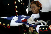 Elizabeth Gallagher weeps as marines prepare the flag to make it into a triangle before handing it to her at National Cemetary in Bourne.  Funeral for Patrick Gallagher a Marine from fairhaven was held at St. Mary's church on Main St. in Fairhaven with the burial being held at the National Cemetary in Bourne.   Local and State officials were present for the somber event.  Marine Lance Cpl. Patrick J. Gallagher 27, of Jacksonville, Fla.; assigned to elements of the 1st Marine Logistics Group, I Marine Expeditionary Force, Camp Pendleton, Calif.; died April 2 when the seven-ton truck he was riding in rolled over in a flash flood near Asad, Iraq. Also killed were: Cpl. Andres Aguilar Jr., Cpl. David A. Bass, Lance Cpl. Felipe D. Sandoval-Flores, Cpl. Brian R. St. Germain and Staff Sgt. Abraham G. Twitchell.
