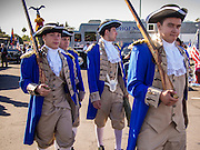"11 NOVEMBER 2013 - PHOENIX, AZ: High school students dresses as Continental Army soldiers of the Revolutionary War walk through the Phoenix Veterans Day Parade grounds. The Phoenix Veterans Day Parade is one of the largest in the United States. Thousands of people line the 3.5 mile parade route and more than 85 units participate in the parade. The theme of this year's parade is ""saluting America's veterans.""      PHOTO BY JACK KURTZ"
