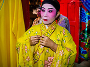"""12 JANUARY 2018 - BANGKOK, THAILAND: Chinese opera performers put on their costumes before a performance at the Chaomae Thapthim Shrine in the Dusit district of Bangkok. Many Chinese shrines and temples host Chinese operas during the Lunar New Year. Lunar New Year is 16 February this year and opera troupes are starting their holiday engagements at local Chinese temples and shrines. The new year will be the """"Year of the Dog."""" Chinese New Year, also called Lunar New Year or Tet, is widely celebrated in Chinese communities around the world. Thailand has a large Chinese community and Lunar New Year is an important holiday.     PHOTO BY JACK KURTZ"""