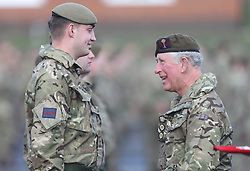 The Prince of Wales (right)talks with soldiers from the 1st Battalion Welsh Guards at Elizabeth Barracks in Woking, following their return from Afghanistan as he presents them with their campaign medals.