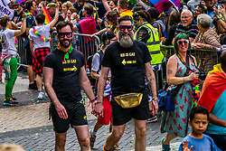 May 25, 2019 - Birmingham, Birmingham - West Midlands, United Kingdom - Members of the LGBTQ community are seen taking part during the Birmingham Pride parade..Birmingham Pride this year is endorsing the controversial of No Outsiders educational programme, organisers are hopeful that this year's event will be the biggest in its 22 year history, with the largest Muslim contingent ever seen at Birmingham Pride, an annual festival for the LGBTQ community usually takes place over the Spring Bank Holiday. The event begins with a parade from Victoria Square in the city centre to the Gay Village in Hurst Street. (Credit Image: © Jim Wood/SOPA Images via ZUMA Wire)