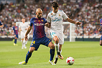 Real Madrid's Marco Asensio and FC Barcelona's Javier Mascherano during Supercup of Spain 2nd match at Santiago Bernabeu Stadium in Madrid, Spain August 16, 2017. (ALTERPHOTOS/Borja B.Hojas)