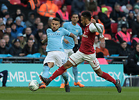 Football - 2018 Carabao (EFL/League) Cup Final - Manchester City vs. Arsenal<br /> <br /> Pierre-Emerick Aubameyang (Arsenal FC) almost steals the ball from Nicolas Otamendi (Manchester City) at Wembley.<br /> <br /> COLORSPORT/DANIEL BEARHAM