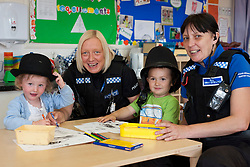 Milly Bayliss with PC Beverly Drabble and Charlie Airey with PCSO Sue Shaw at the Treetops Nursery on Thursday where Notinghamshire Police helped the nursery take part in the Child Safety week with a visit from the members of the Safer neighborhoods team<br /> 27 June 2013<br /> Image © Paul David Drabble<br /> www.pauldaviddrabble.co.uk