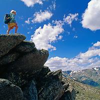 A young hiker views Absorka-Beartooth Wilderness from Beartooth Pass.