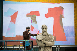"""© Licensed to London News Pictures . 16/07/2017 . Manchester , UK . Gruff Rhys of the Super Furry Animals performs """" Communism's Coming Home"""" at the closing event of the Manchester International Festival at Home arts venue (formally the Cornerhouse) in Manchester City Centre , featuring dance, music, socialist workshops , all in the shadow of the newly unveiled statue of Friedrich Engels , at Tony Wilson Place . Photo credit : Joel Goodman/LNP"""