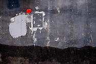 Painting-like weathered wall lining the old hutong streets of Beijing, China, Asia