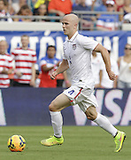 JACKSONVILLE, FL - JUNE 07:  Midfielder Michael Bradley #4 of the United States dribbles during the international friendly match against Nigeria at EverBank Field on June 7, 2014 in Jacksonville, Florida.  (Photo by Mike Zarrilli/Getty Images)