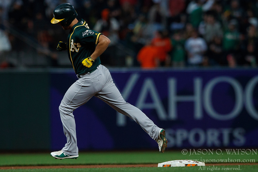 SAN FRANCISCO, CA - JULY 13: Chad Pinder #18 of the Oakland Athletics rounds the bases after hitting a home run against the San Francisco Giants during the fifth inning at AT&T Park on July 13, 2018 in San Francisco, California. The San Francisco Giants defeated the Oakland Athletics 7-1. (Photo by Jason O. Watson/Getty Images) *** Local Caption *** Chad Pinder