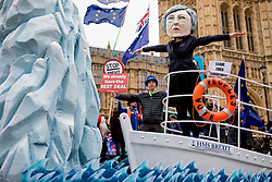 "© Licensed to London News Pictures. 15/01/2019. London, UK. A campaigner wearing a Theresa May mask stands on the bow of the ""HMS Brexit"" in Old Palace Yard opposite Parliament. MPs will vote on Prime Minister Theresa May's Brexit deal this evening. Photo credit: Rob Pinney/LNP"