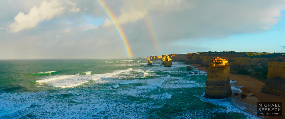 A rainbow appears over the Twelves Apostles ahead of squally showers.<br /> <br /> Code: CAVS000<br /> <br /> Open Edition / Stock Image